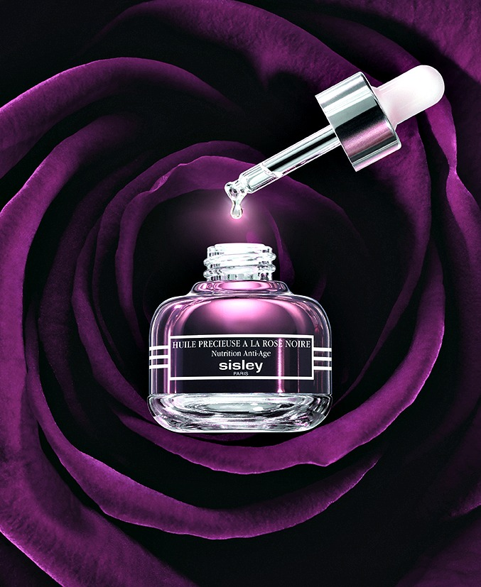 Sisley Precious Black Rose Oil with background